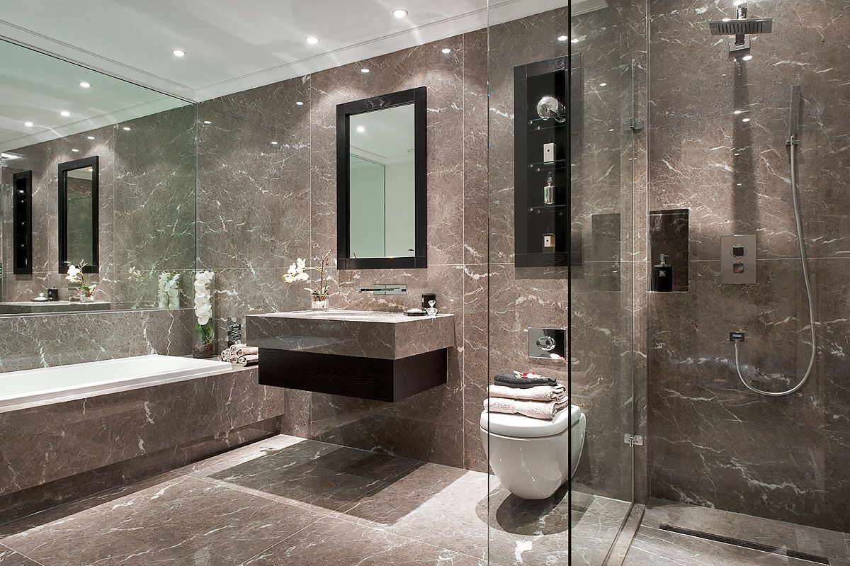 A Muted Marble Bathroom With Dark Oak Inset Storage And Walk In Glass  Fronted Shower
