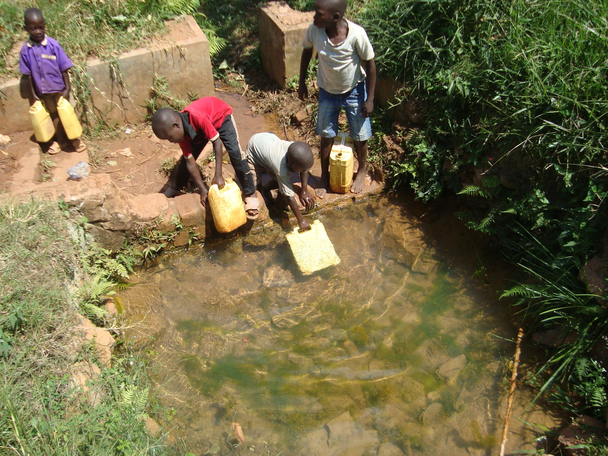 Collecting water, Uganda.