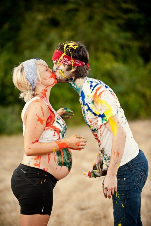 Paint-covered maternity photos