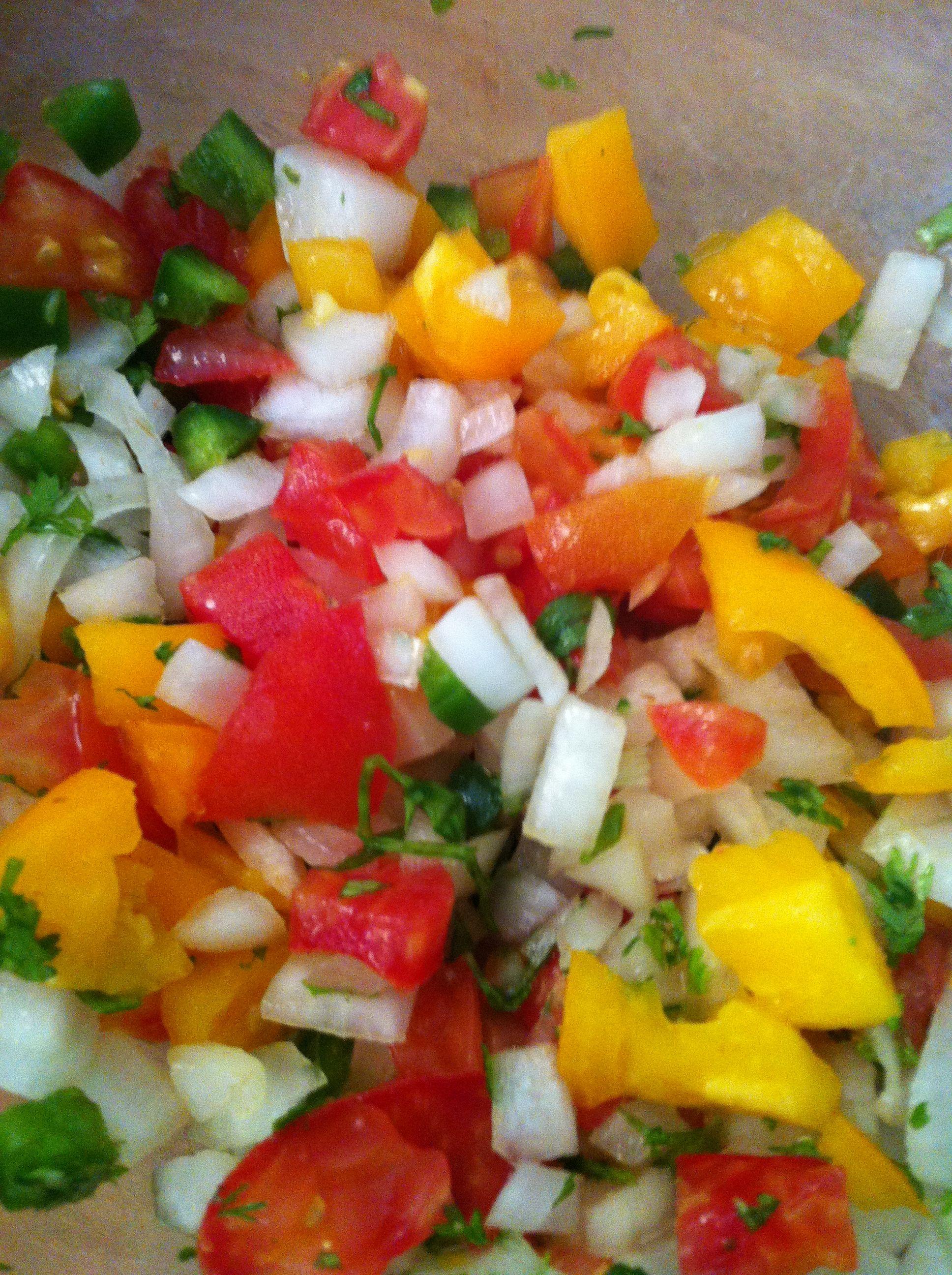 Heirloom tomato pico de gallo.  Combine two tomatoes, chopped, 1/2 onion, diced, 1/2 jalapeño, minced, handful cilantro, chopped, 1/2 lemon squeezed onto above, salt to taste. Mix together.