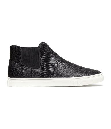 abe507b04a8 High top slip-on sneaker in a black snakeskin pattern with white ...