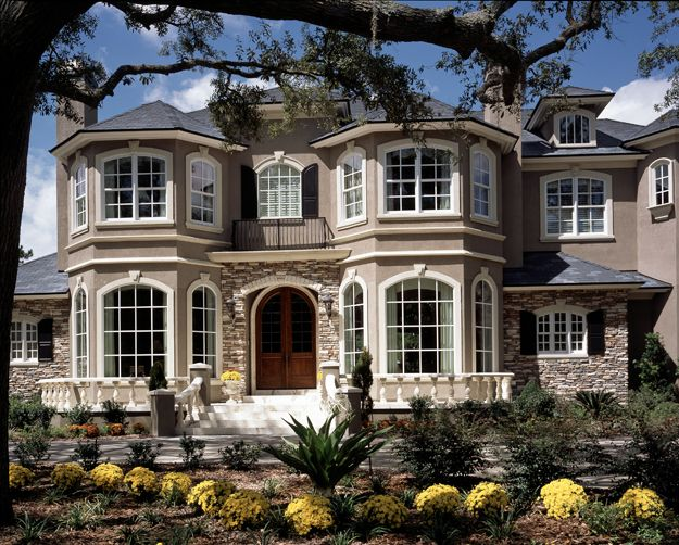 Two Symmetrical Turrets Make This Facade Commanding Yet Elegant In This Lar Luxury House Plans Mediterranean Style House Plans Modern Contemporary House Plans