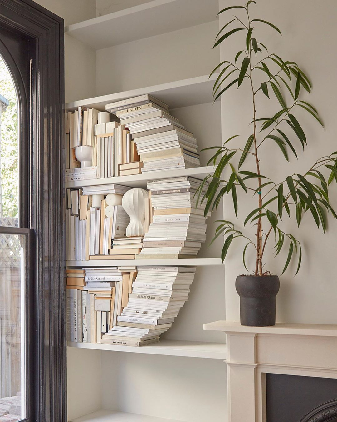Domino On Instagram Cool Styling Idea Of The Day Create A Curved Nook For Your Books What Do You Think Swipe Bookcase Styling Home Decor White Bookshelves