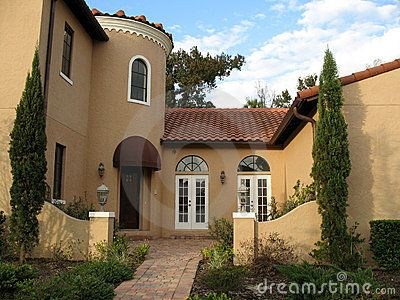 Stucco exterior home color schemes terra cotta roof for Mediterranean stucco