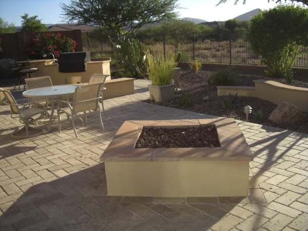 A Desert Backyard With A Large Manufactured Brick Floor Connecting The  Outdoor Kitchen, Patio,