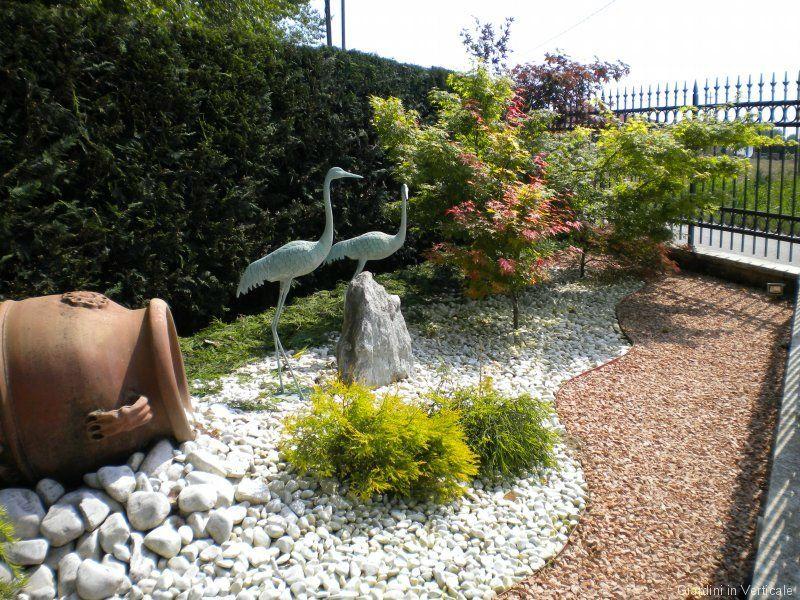 Risultati immagini per sassi da giardino per aiuole for Aiuole giardino con sassi
