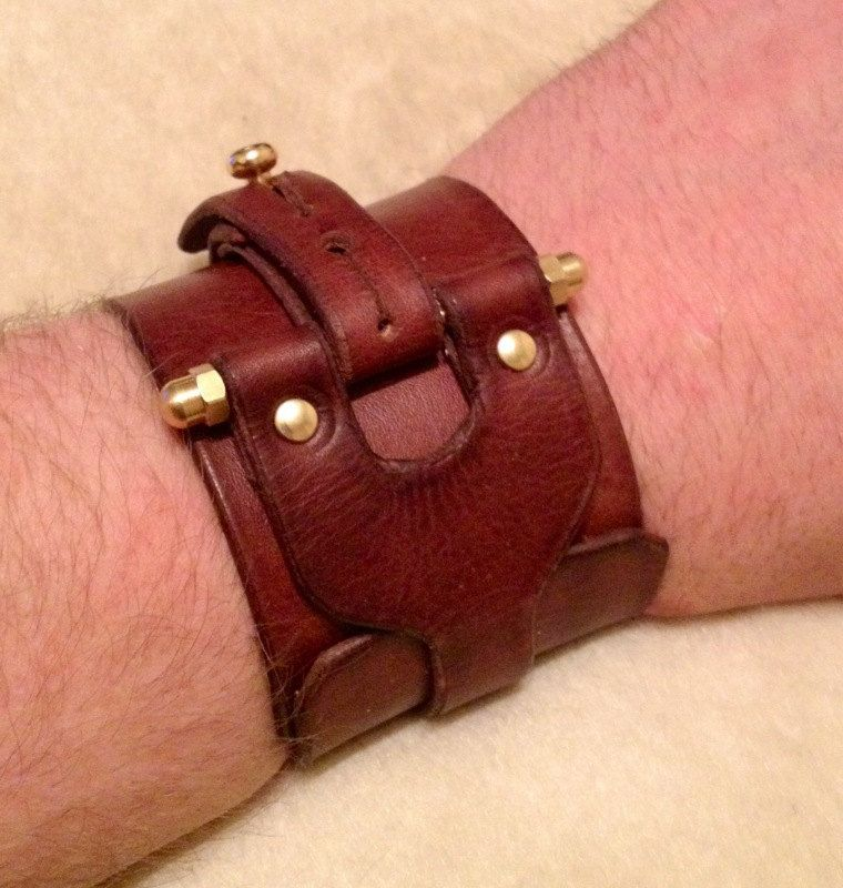 """Leather Steampunk Cuff. """"The Patton Industrial protective cuff"""". via Etsy."""