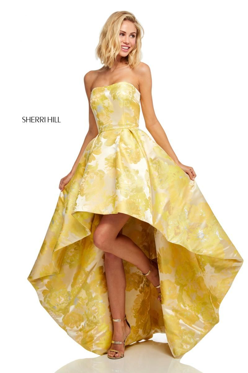 a856fb80589 Style 52416 from Sherri Hill is a high low strapless prom dress in a floral  print.