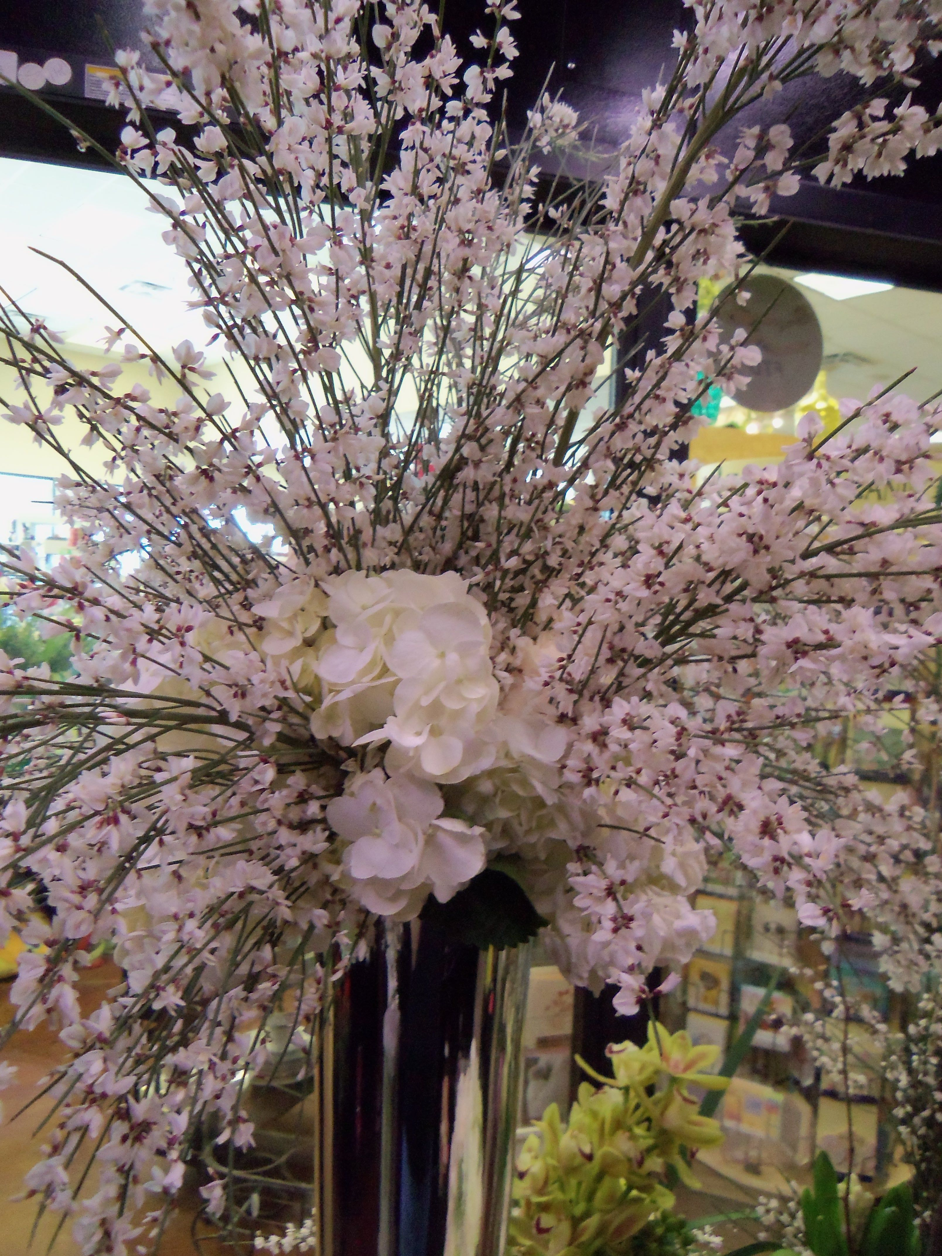 Beautiful tall white wedding centerpiece, hydrangea, roses, and more