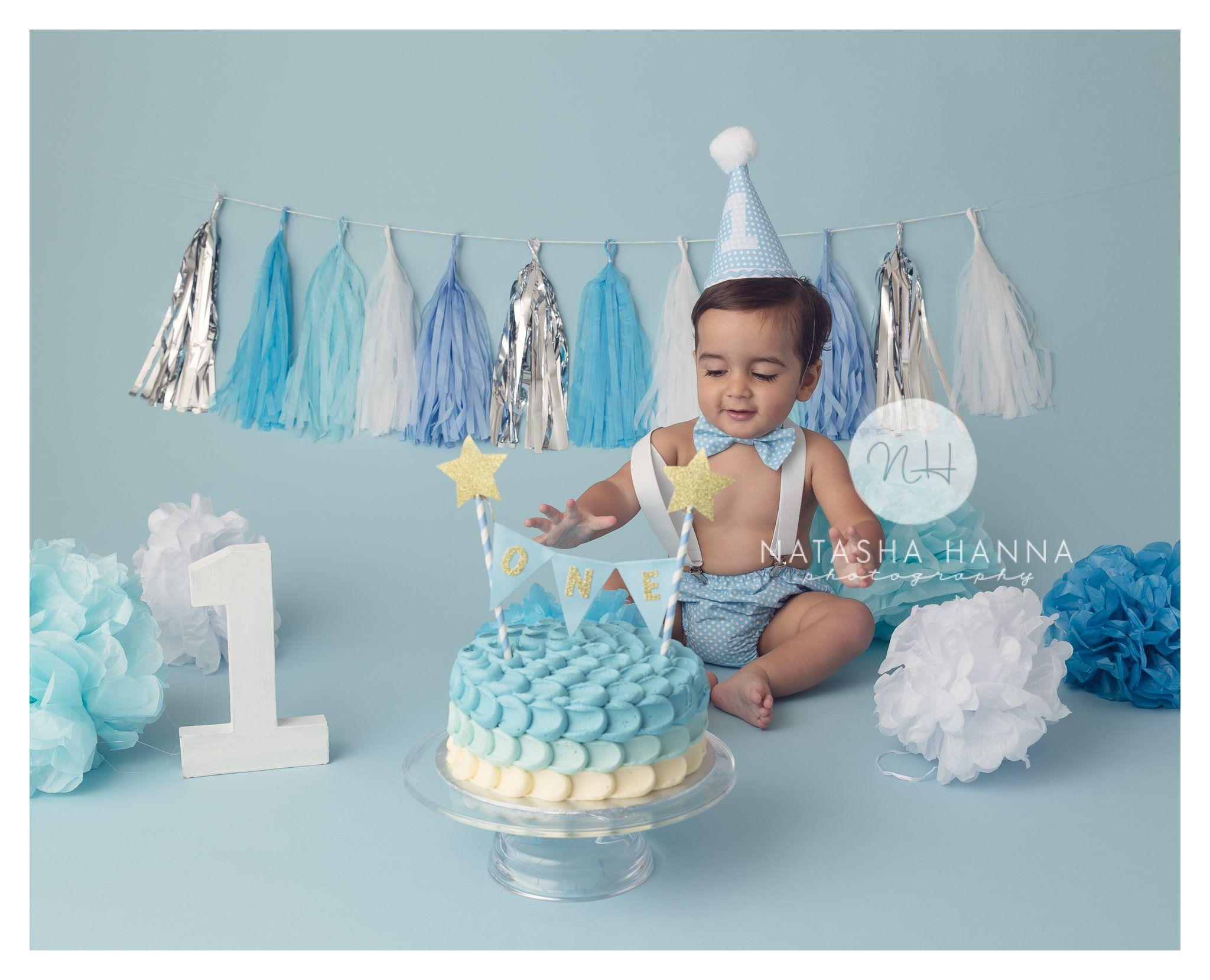 Cake smash photography blue boy set up with tassel