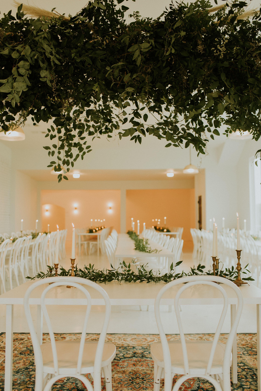 Cozy Wedding Reception with Plenty of Greenery and Warm