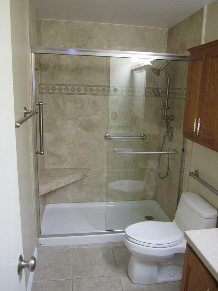 ada bathroom showers narrow handicap shower stalls nice use of rails and corner seat like the larger tiles not sure flooring door slides sideways