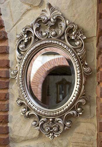 Espejo con marco ovalado decorado con volutas en color - Espejos marco plateado ...