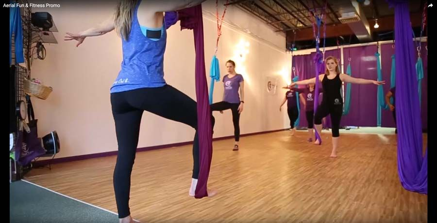 In the studio students use aerial silks in class Aerial