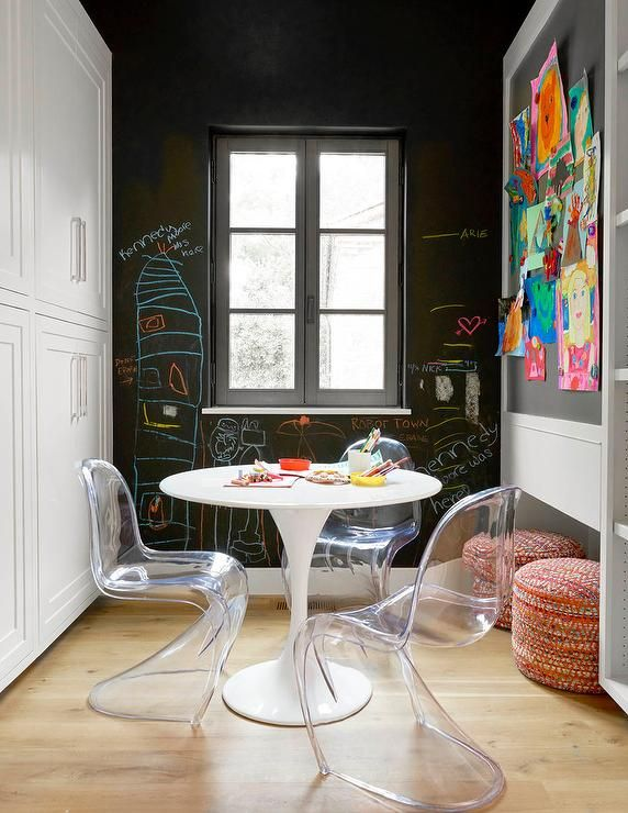 Contemporary Playroom Features An Ikea Docksta Table Lined With Clear  Acrylic Vitra Panton Chairs Placed In Front Of A Large Chalkboard Accenu2026