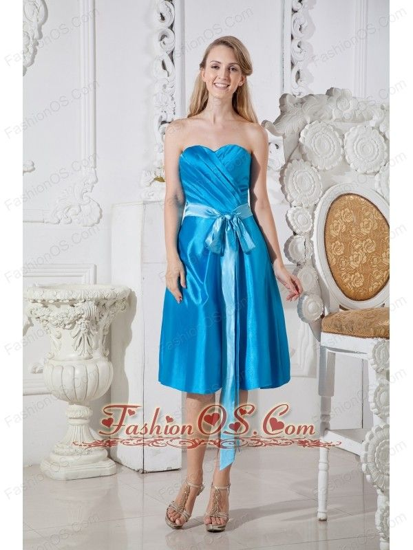 Teal Empire Sweetheart Short Prom Dress Taffeta Ruch and Bows Knee-length  http://www.fashionos.com  Pure simplicity can be a charming virtue, and it's one exemplified in this Pretty Maids dress. The simple, sincere cut frames your figure while the wide satin ribbon belts the waist in before tying over the left shoulder and streaming down toward the ankle. The hem of the dress falls just below the knee. Ruched in front of the bodice and zipper back!