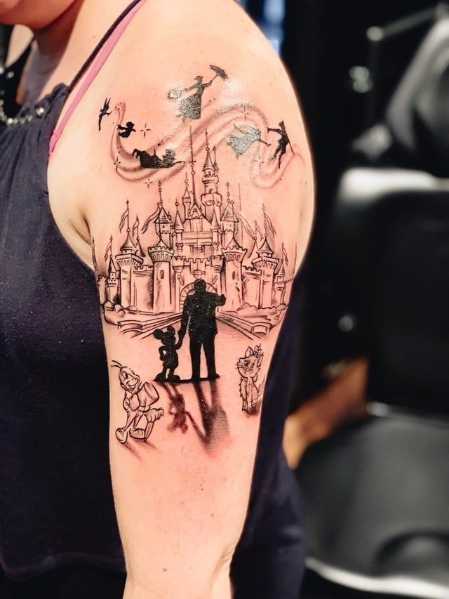Beautiful Disneyland tattoo. Walt and Mickey Friends statue, the castle and fireworks