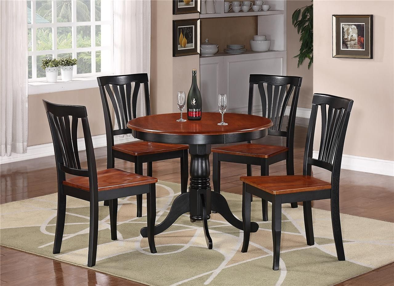 Round kitchen table and chairs with glass window and curtain also