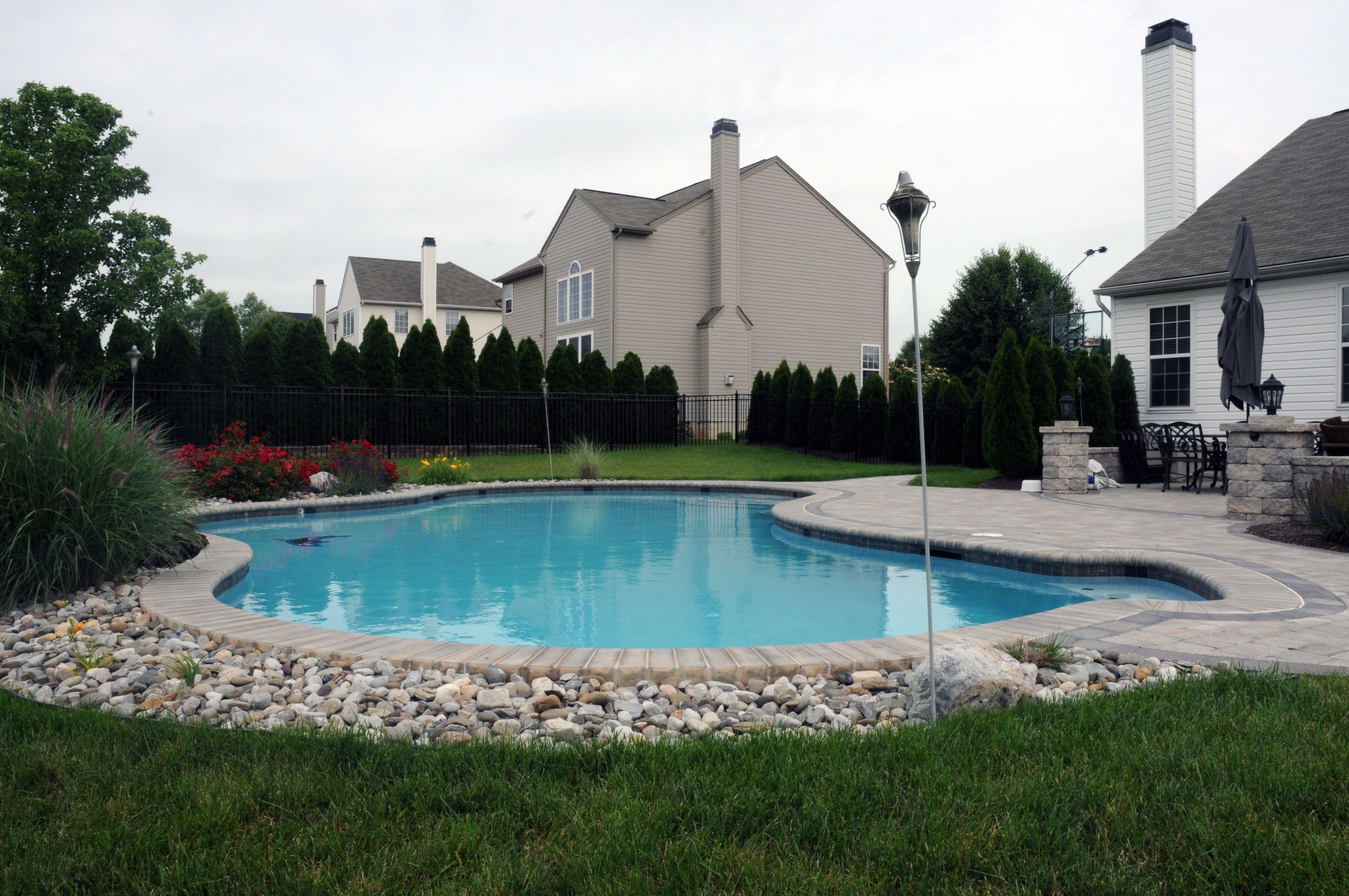 River Rocks Around The Edge Would Be Great All Around The Pool Concrete To Help Keep W Landscaping Around Pool Inground Pool Landscaping Pool Landscape Design