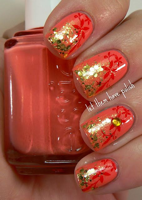 So for this I sponged Boom Boom Pow over Essie's Tart Deco. Then I stamped using this pretty flower design from Konad Plated M9 in Konad Red special polish. Just for fun after it was all said and done I decided it needed a rhinestone and that pulled the whole look together for me.