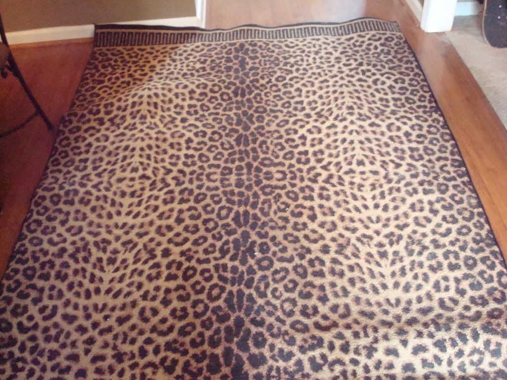 """Leopard Print Area Rug- Large in Graduating's Garage Sale in Raleigh , NC for $75.00. Black w/ light & dark brown. Approx. 7'5"""" x 5'5"""" Just cleaned."""