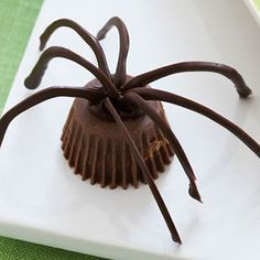 Chocolate Spiders- Using two ingredients and three simple steps, these spooky treats can be made in just thirty seconds.Get more delicious Halloween desserts at redbookmag.com.