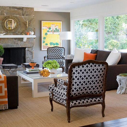 We have a dark brown sofa, cream love seat ottoman, and multi