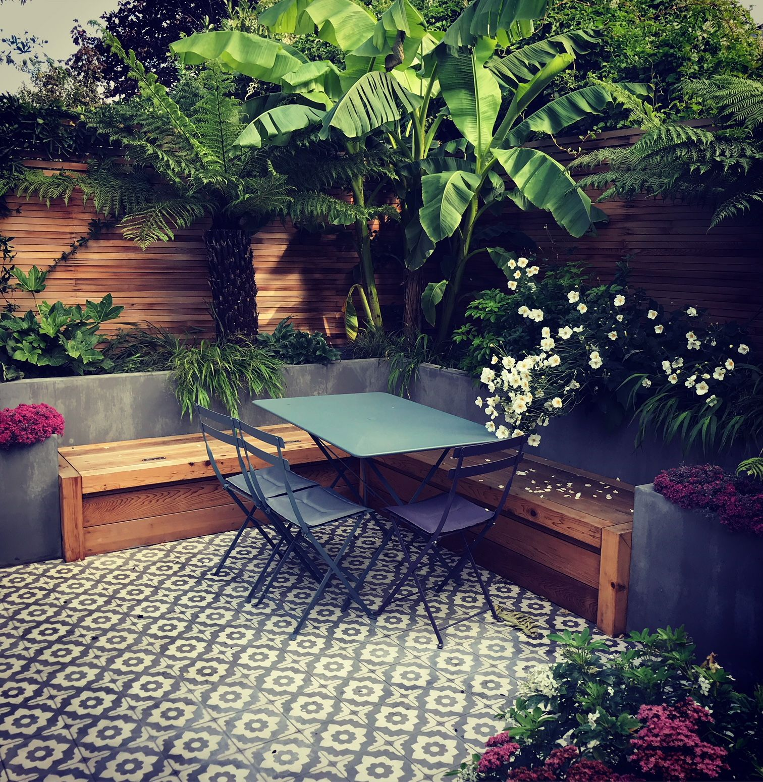 Urban Haven Family Garden With Semi Tropical Planting Designed For Clients In Sw London Tiled Patio Mo Garden Design Front Garden Design Garden Design London