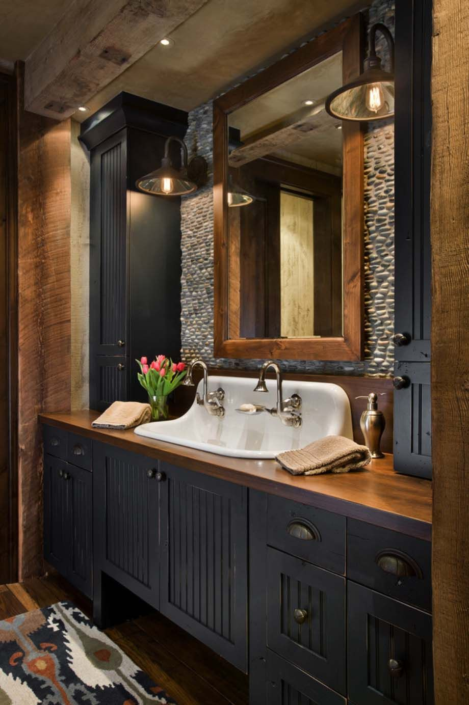 Rustic yet refined mountain home surrounded by Montana's wilderness is part of Farmhouse bathroom decor, Rustic bathroom vanities, Farmhouse master bathroom, Rustic bathroom designs, Modern farmhouse bathroom, Rustic bathrooms - This striking architectural masterpiece was designed by one of our favorites, Locati Architects, located in beautiful SeeleySwan Valley in Western Montana