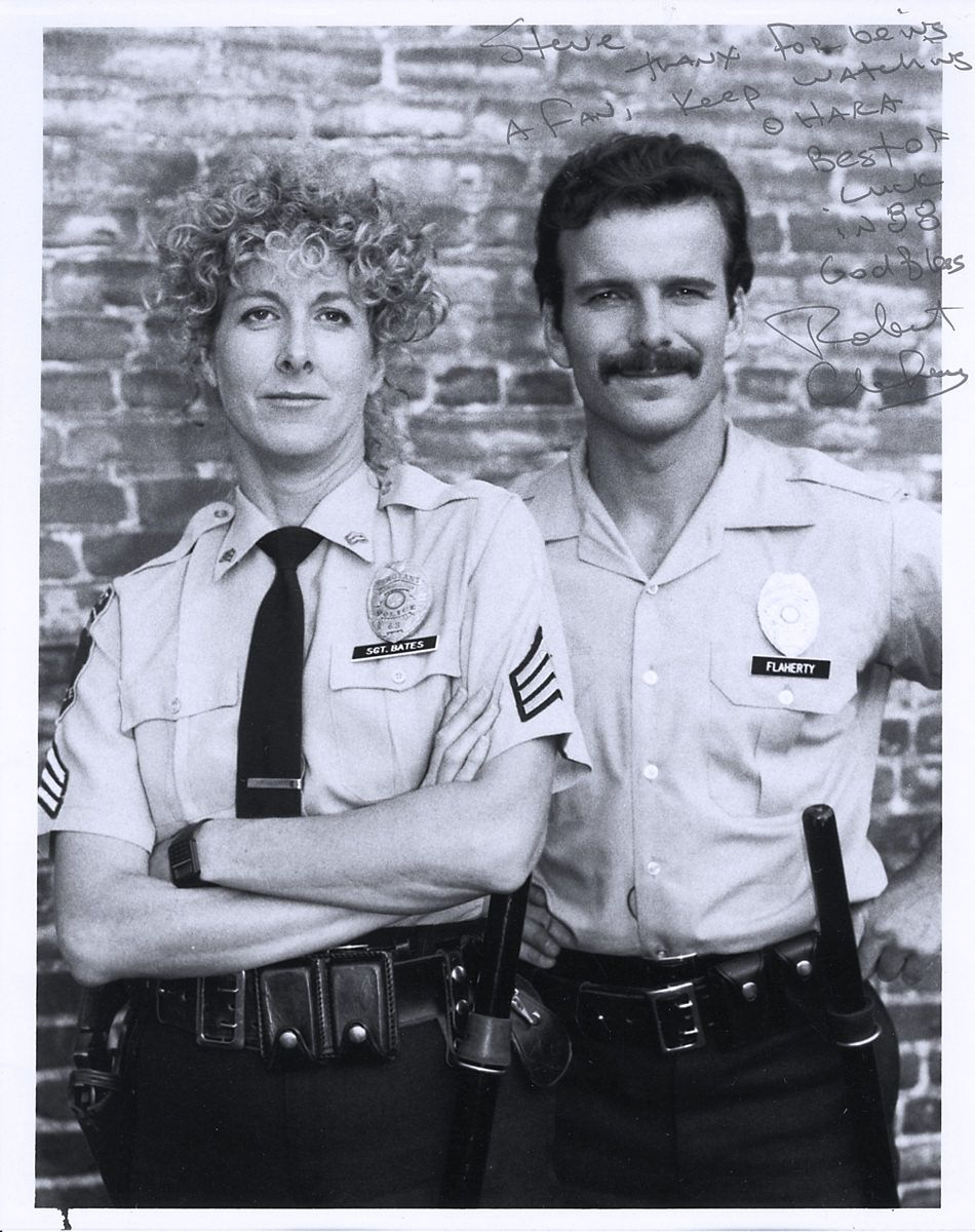 Betty Thomas as Sergeant Lucille Bates and Robert Clohessy