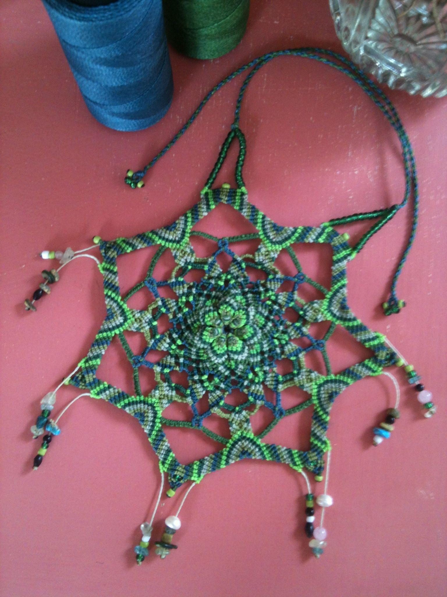 Macramé mandala for the heart chakra with pearl, blue apatite, rose quartz, prehnite, serpentine. Only took 7hours to make!! :)