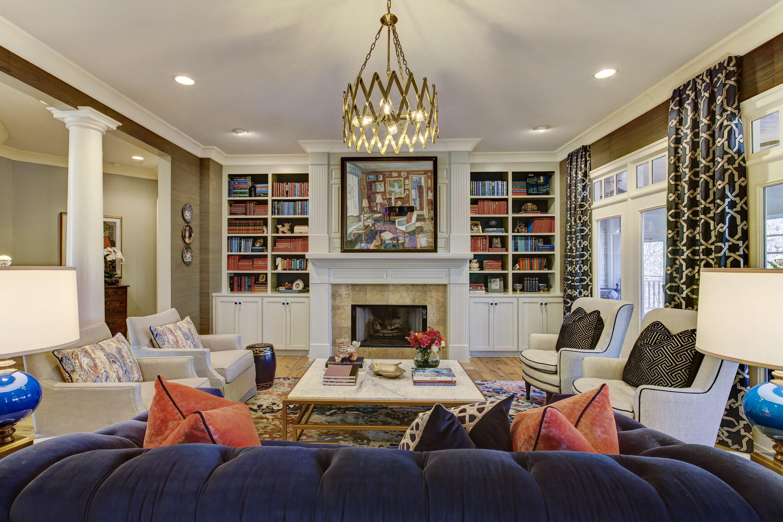Living Room Color Coordinated Bookcases Built Ins White Columns Original Artwork Over Fireplace Navy Velvet Sofa Coral Accents Cus Built Ins Design Room