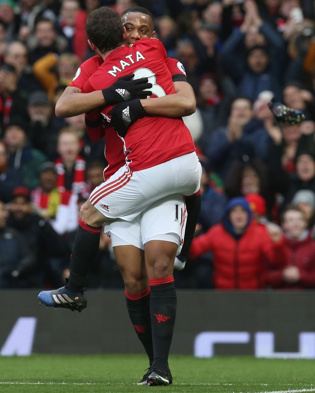f75549943e3 Juan Mata celebrates scoring with Anthony Martial