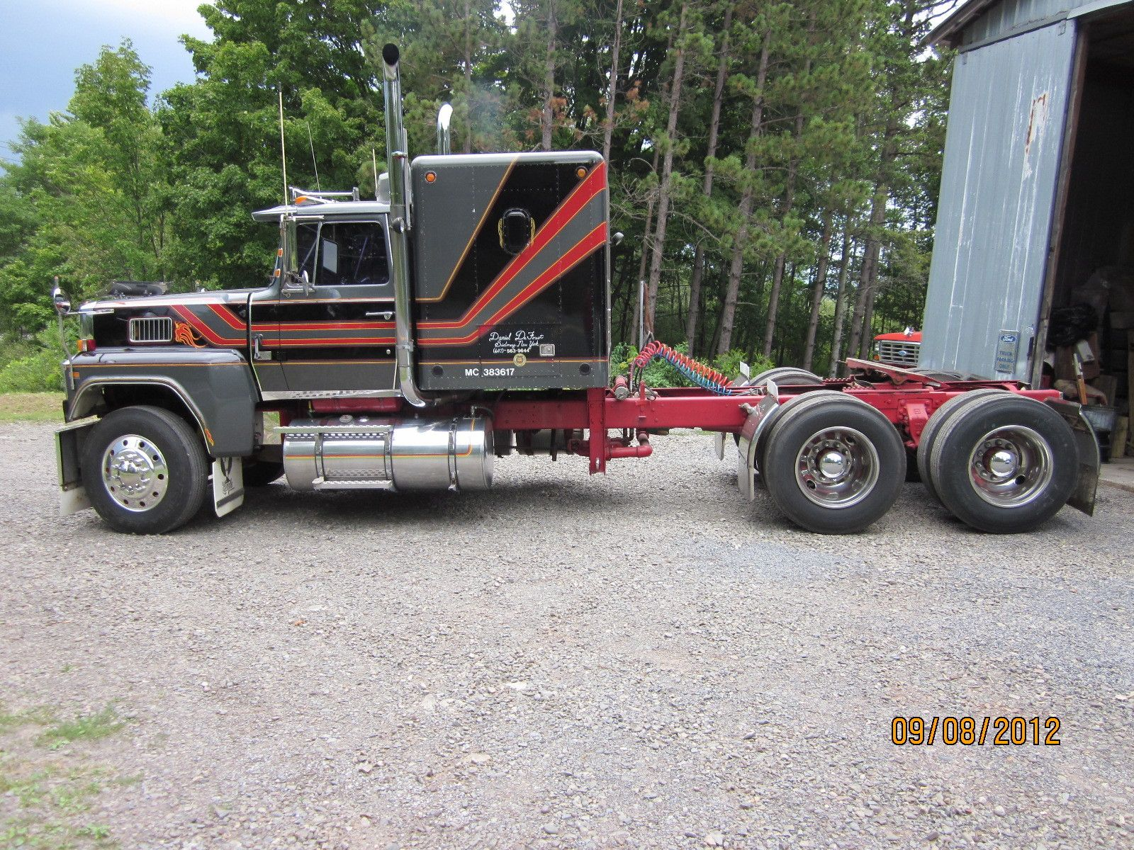ford ltl 9000 with this sleeper and stripe design big