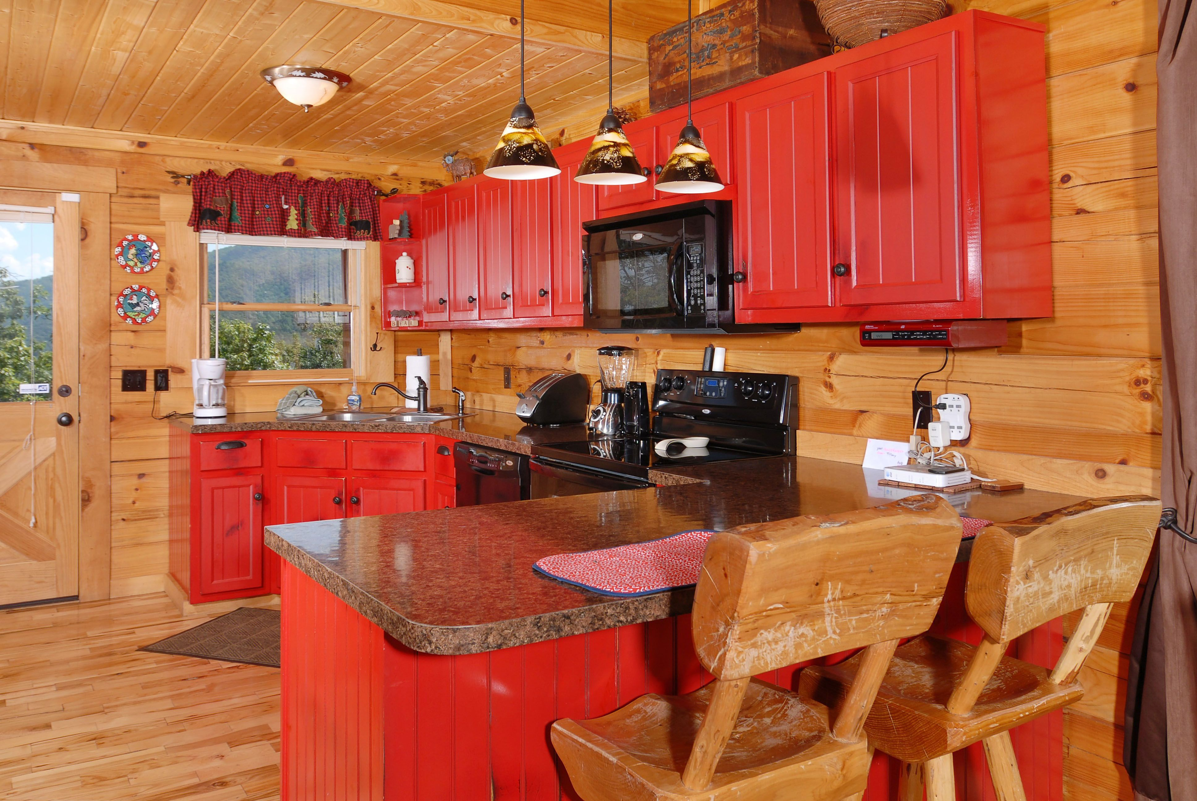Red cabinetry ads fun and color to this Log Cabin kitchen | Kitchen ...