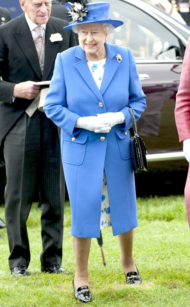 2013 Queen Elizabeth—in a floral-print frock, blue coat and matching topper—and Prince Phillip attended a derby event in Surrey, England