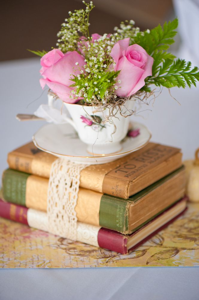 Old Books And Teacup Wedding Centerpiece This Is Happening Getting Married At Tea Book Centerpieces Rustic Wedding Centerpieces Spring Wedding Centerpieces