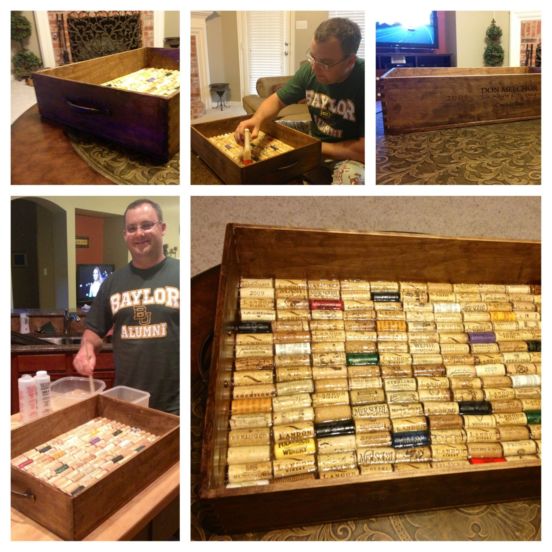 Jeff made a coffee table tray from a shallow wood wine crate we picked up from Goody Goody. Sanded & stained the wood then used wood glue to set the wine corks. Then poured epoxy over the corks. We love it!
