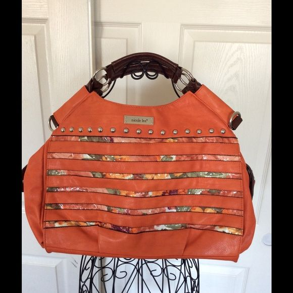 Nicole Lee Bag Orange leather like hobo bag, dark brown hand held stripes, has a attachable shoulder strap ,garden design in front , zipper pocket inside and outside zipper for closing , back has a zipper pocket as well. Still like new only worn once never took off plastic wraps . Only defect is small bite marks from puppy love as displayed in pics . Nicole Lee Bags Hobos