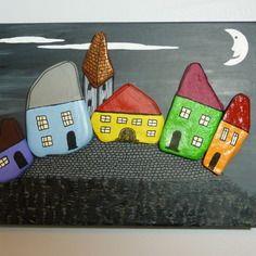 tableau galets peints village de