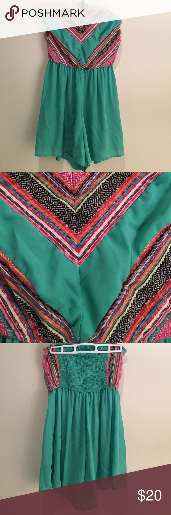 Teal Romper With Aztec Design Romper by the brand West 36th. Purchased at a local boutique. The romper is a teal blue color and features a multicolor Aztec design on the top of the front. The top of the back is elastic for comfortable wear. It is strapless. 100% Polyester. The tag says dry clean only, but I have had no problems machine washing this on the delicate cycle. Dresses