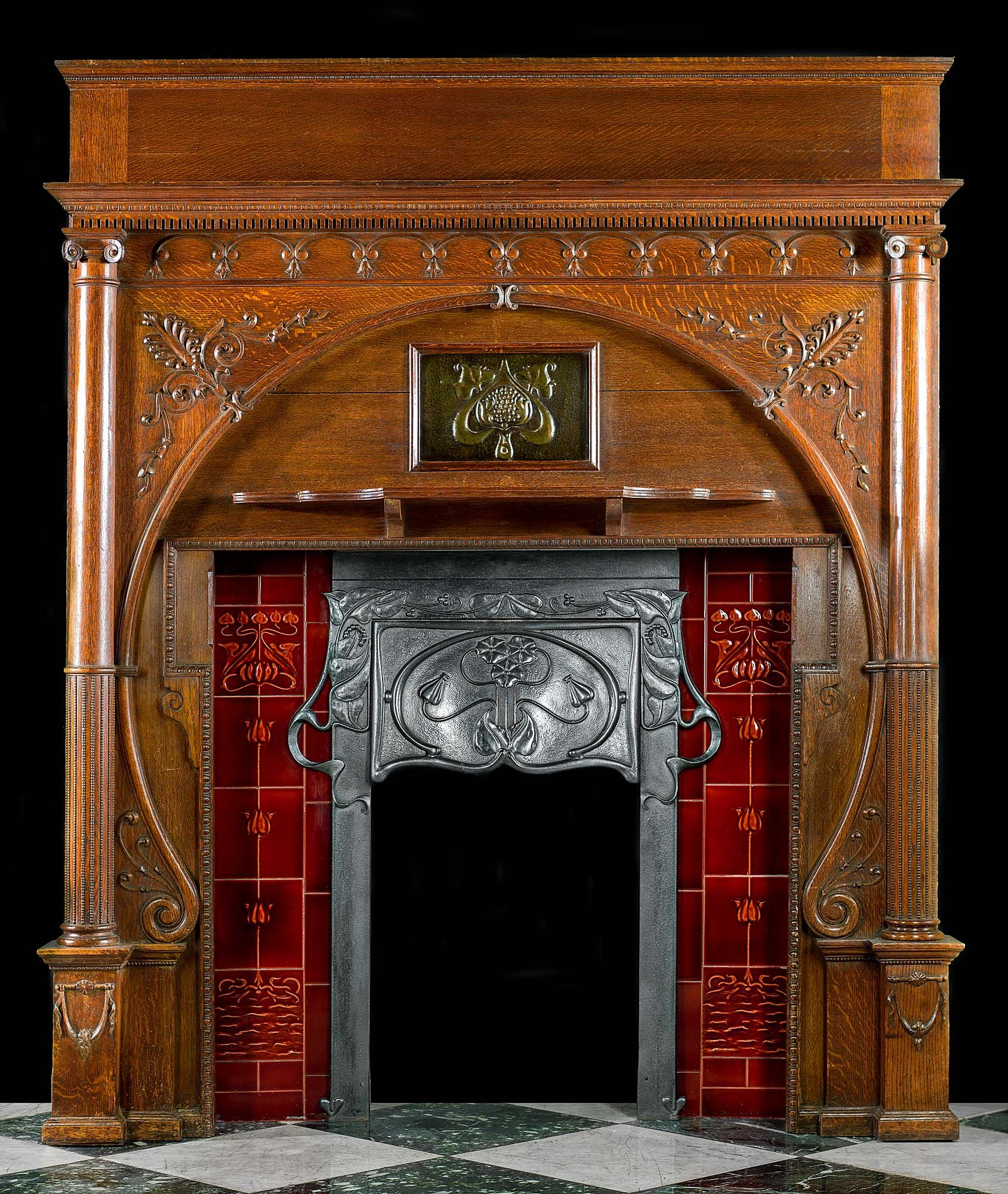 an exceptional and rare tall carved oak art nouveau chimneypiece