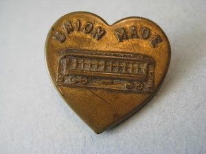 really cool heart shaped button   it says