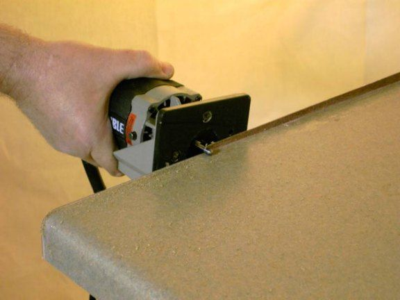Photo Showing End Cap Being Flush Trimed With Small Hand Held Laminate Trim Router Laminate Trim Router Laminate Countertops