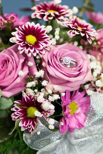 Rings in wedding flowers shot