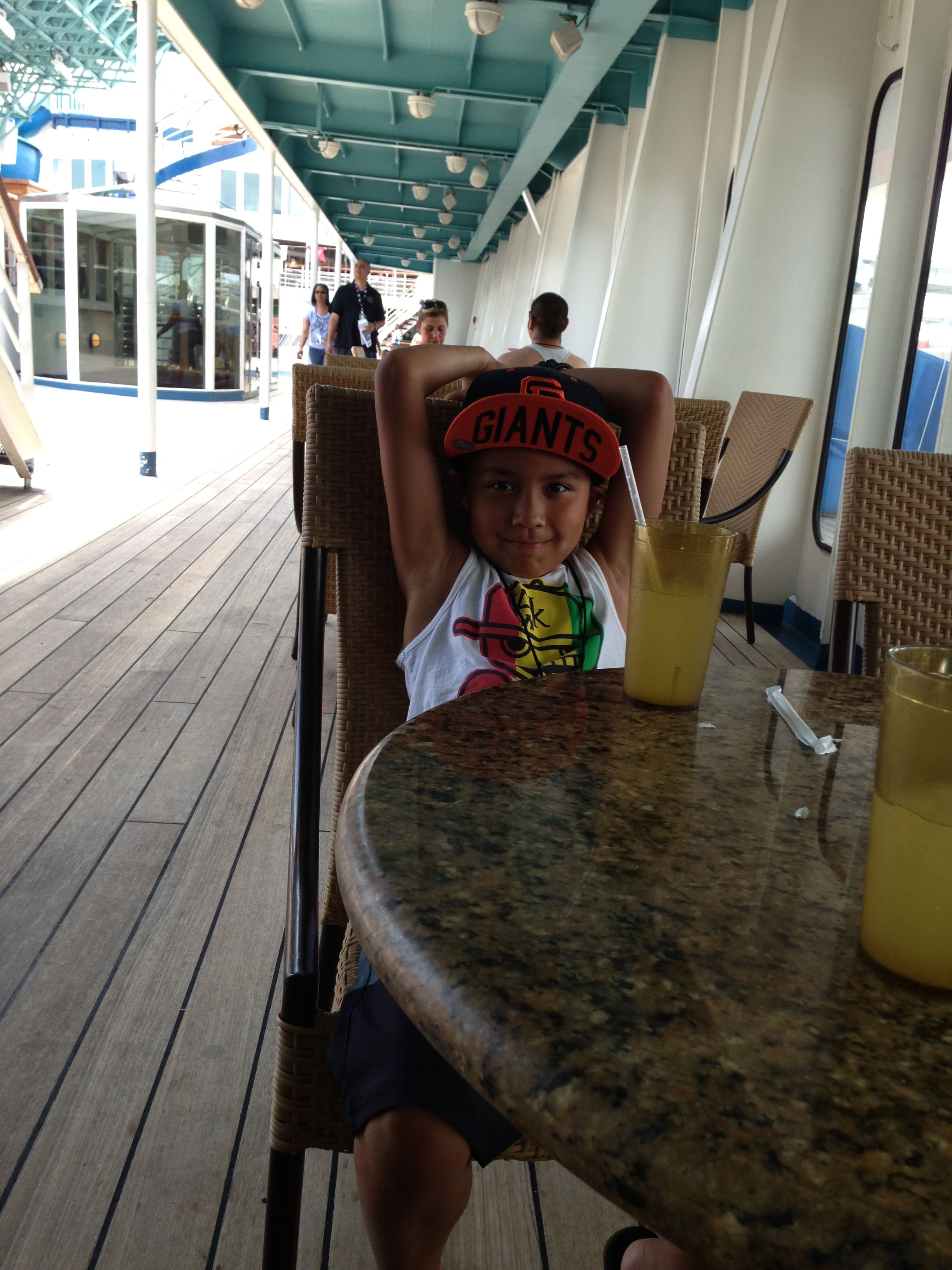 On board the carnival elation, our first cruise.  Definitely going to do this again!  Here  Camilo is  enjoying some music and is already bugging to get on the water slide.