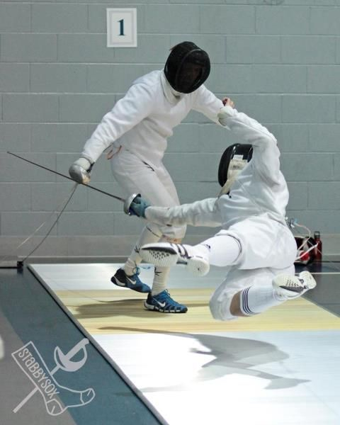 """That's one hell of a move! One of the fencers is airborne! Hard to do & needs a lot of confidence to pull this off. (I knew it as the """"balestra lunge"""".)"""