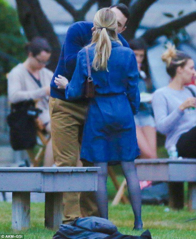 Big kiss: James held Emma's head as he gave her a kiss