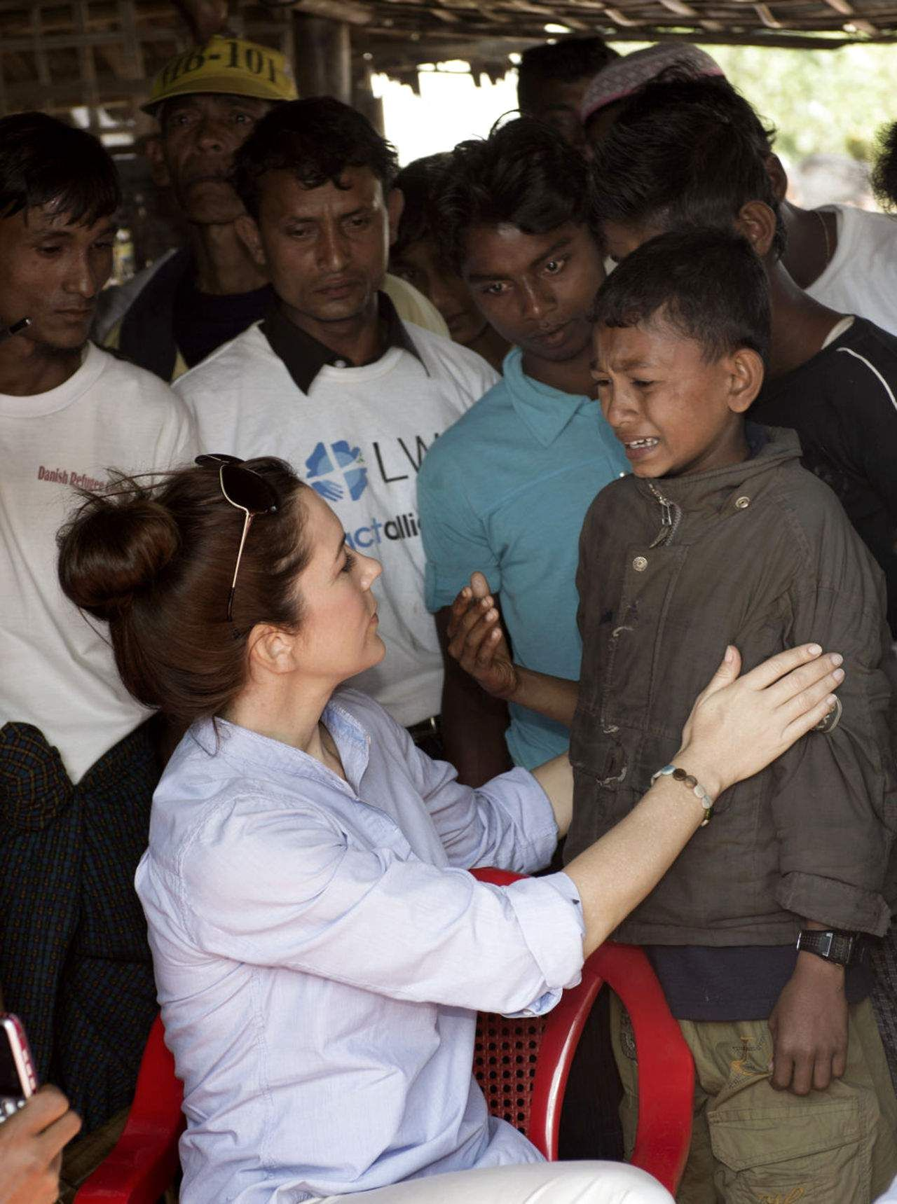 Denmark's Crown Princess Mary comfort a little boy who suddenly broke down and told about his parents during a visit to a tea bar in Say Tha Mar Gyi-camp. The camp outside Sittwe is a  home to Muslim refugees, 12.01.14