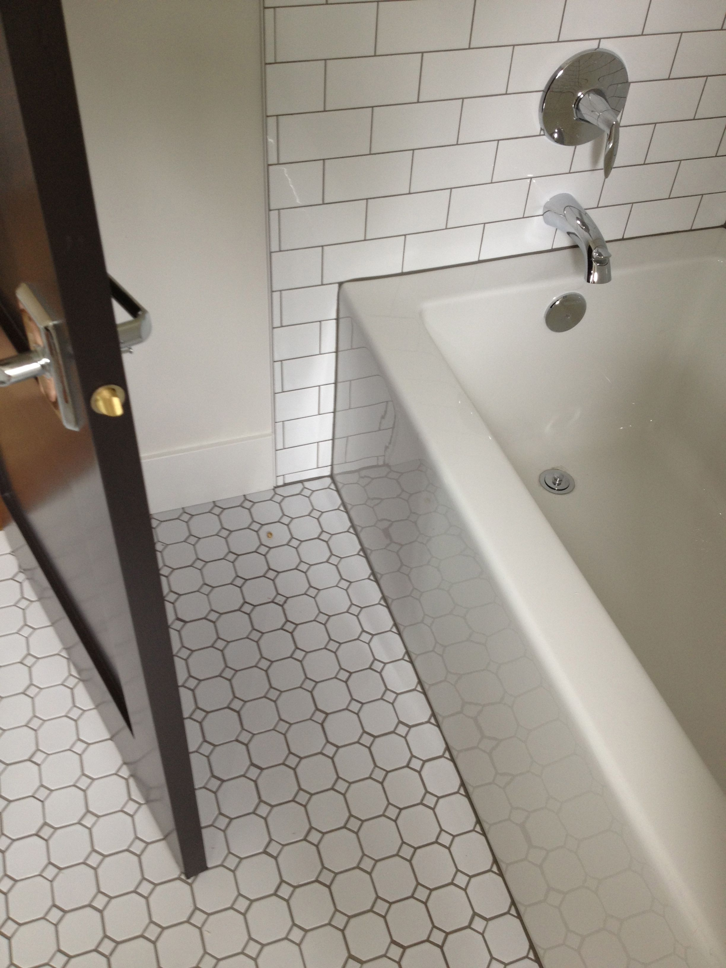 Hexagon tiles with subway crisp and clean appropriate for 1930s floor tiles